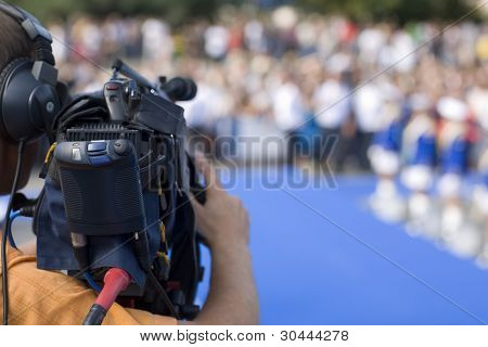 Operator television camera during a public event space.