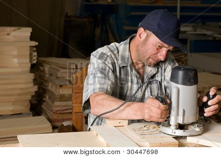 Carpenter working in the woodworking shop.