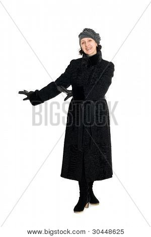Elegant woman in a fur coat from broadtail (karakul, astrakhan, lambskin).