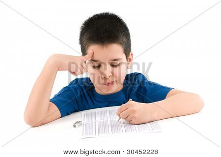 Child thinking to answer test score sheet.