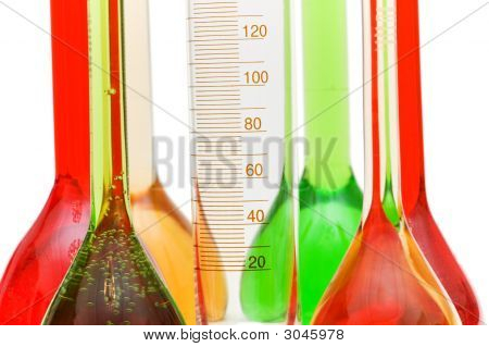 Measuring Glass And Coloured Retorts On White