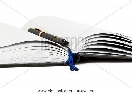 Cuaderno con pluma