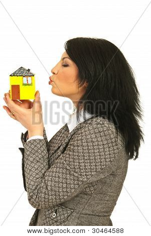 Business Woman Kissing Miniature House