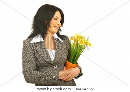 Happy Woman Embracing Flowers