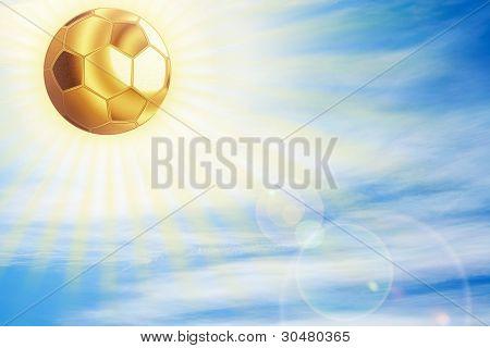 Golden Football Ball Shining Over Sky.