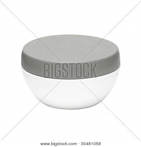 White Plastic Jar With A Dark Cap