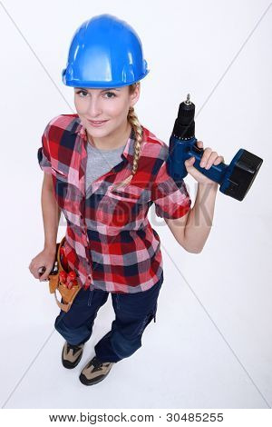 young craftswoman holding a drill