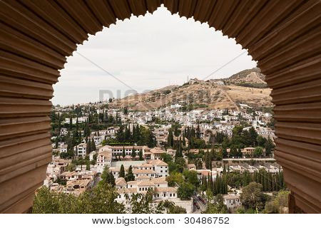 View Of Granada Through A Moorish Window Of The Alhambra
