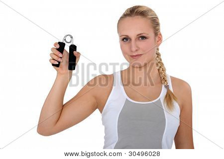 Young woman holding hand grippers
