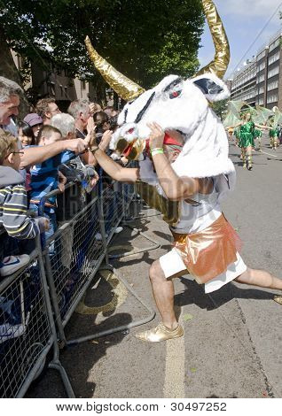 Minotaur Dancer From The London School Of Samba Greets The Crowd At The Notting Hill Carnival