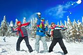 stock photo of snowball-fight  - Guys having snowball fight in snow in winter background - JPG