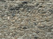 Texture Of A Stone Wall. Old Castle Stone Wall Texture Background. Stone Wall As A Background Or Tex poster