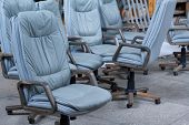 Several Gray Leather Office Chairs Ready For Packaging In A Furniture Warehouse, Online Furniture St poster