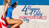 Beautiful Cheerful Woman Holding An American Flag On The Beach. poster