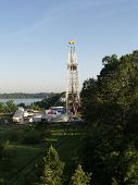 stock photo of shale  - Tatum TX  - Rig drills a 2nd hole next to the Martin Lake State Park in East Texas part of the Haynesville  field they drill down over 11000 ft before going horizontally ** Note: Slight blurriness, best at smaller sizes - JPG
