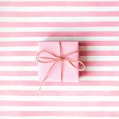 Pink Gift Box With A Pink Ribbon On A Pink Background .  Holiday Concept. Copy Space. poster
