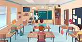 Lesson In Classroom. Pupils At Desks And Teacher Standing And Pointing Kids Study Near Chalkboard Ve poster