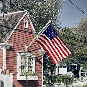 United States flag at suburban neighborhood. Provincetown, Cape Cod, Massachusetts, USA.  poster