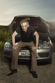 Aging Desperate Man Trying To Fix Broken Car Engine On Lonely Way poster