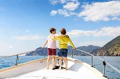 Two Little Kid Boys, Best Friends Enjoying Sailing Boat Trip. Family Vacations On Ocean Or Sea On Su poster