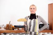 stock photo of pancake flip  - Woman making pancakes - JPG