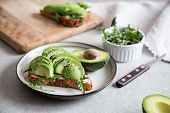 Healthy Breakfast With Avocado And Delicious Wholewheat Toast. Sliced Avocado On Toast Bread With Sp poster