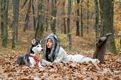 Wild Life. Animal Husbandry. Girl Pretty Stylish Woman Walking With Husky Dog Autumn Forest. Pedigre poster