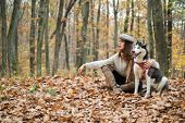Girl Enjoy Walk With Husky Dog. Siberian Husky Favorite Pet. Animal Husbandry. Girl Pretty Stylish W poster