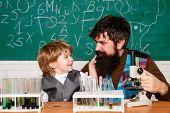 Father Teaching Her Son Chemistry Or Biology In Classroom At School. Homeschooling. Man Teaches Chil poster