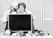 Lets Make Dinner Together. Chef And Cook Helper Gesturing Ok Sign At Blackboard. Couple Of Man And G poster