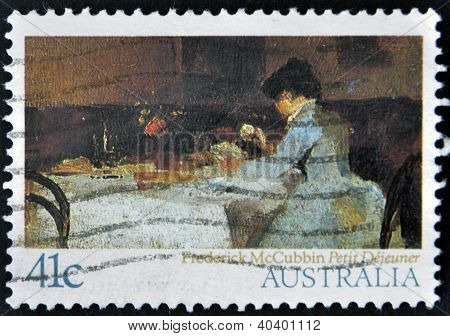 stamp printed in Australia shows Petit Dejeu ner by Frederick McCubbin