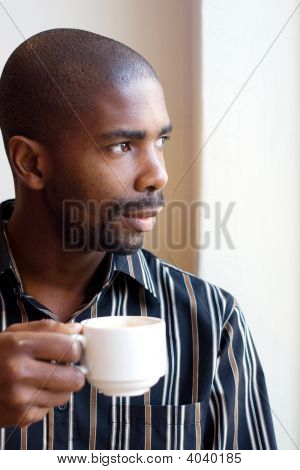 African Man Drink Coffee