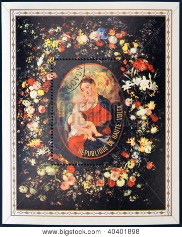 picture of the Virgin and Child Jesus surrounded by garland of flowers