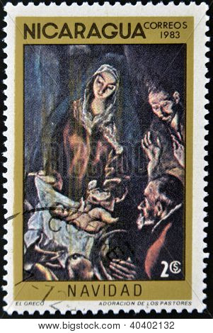 "NICARAGUA - CIRCA 1983: A Stamp printed in NICARAGUA shows the painting ""Adoration the Shepherds"" by"