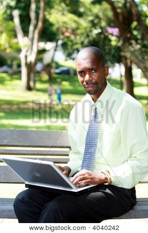 African Businessman Working Outdoors