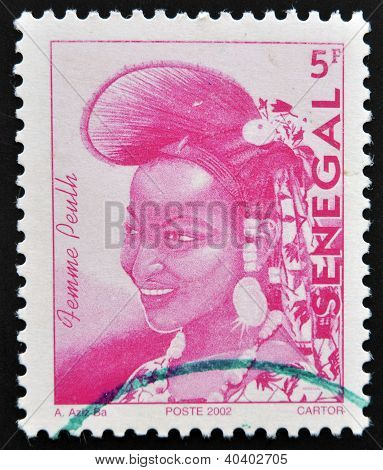 SENEGAL - CIRCA 2002: A stamp printed by Senegal shows a woman of elegance Senegalese Fulani women c