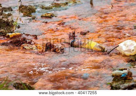 Polluted water flowing after a disaster closeup