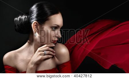 Beautiful woman with jewellery and red color scarf
