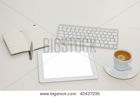 white working place with tablet PC