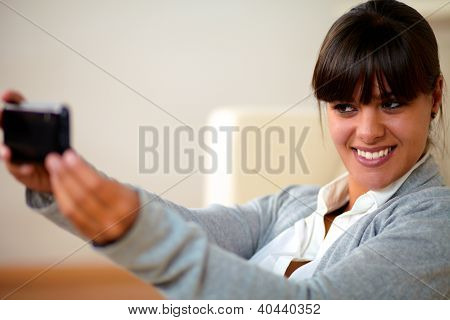 Charming Young Woman Taking A Photo With Cellphone