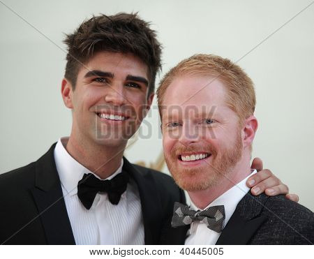 LOS ANGELES - AUG 11:  JESSE TYLER FERGUSON & DATE arriving to Emmy Awards 2011  on August 11, 2012 in Los Angeles, CA