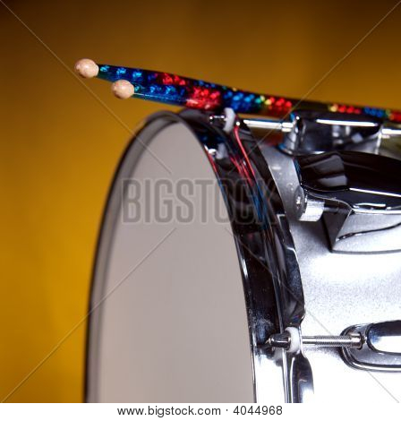 Silver Sparkel Snare Drum And Sicks Isolated On Gold
