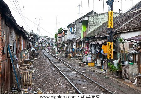 MALANG,JAVA,INDONESIA- JANUARY 8: Unidentified poor people living in slum at January 8, 2012 in Malang on Java, Indonesia. According to 2010 Indonesia reduced their slum populations by more than 40%..