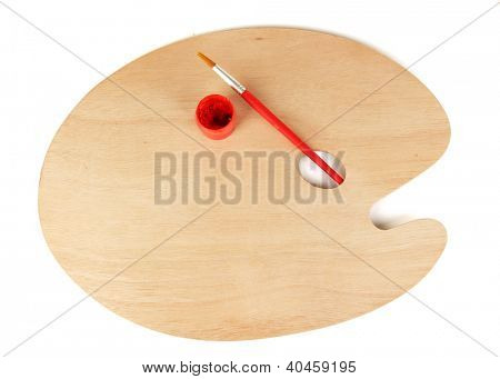 Wooden art palette with brush for painting and paint isolated on white