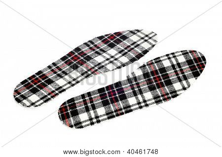 a pair of plaid patterned insoles on a white background