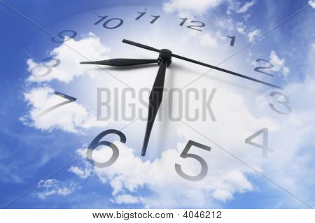 Clock And Cloudy Sky