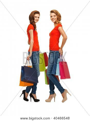 two teenage girls in red t-shirts with shopping bags