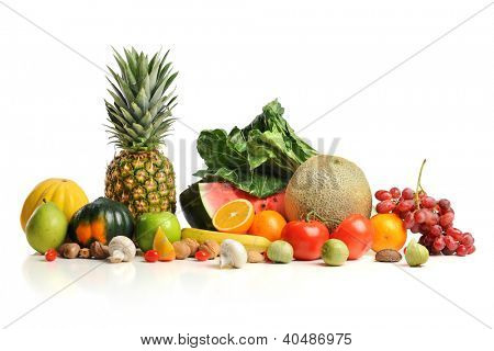 Fruits and vegetables in paper grocery bag isolated over white background