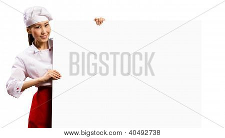 female chef holding a poster for text