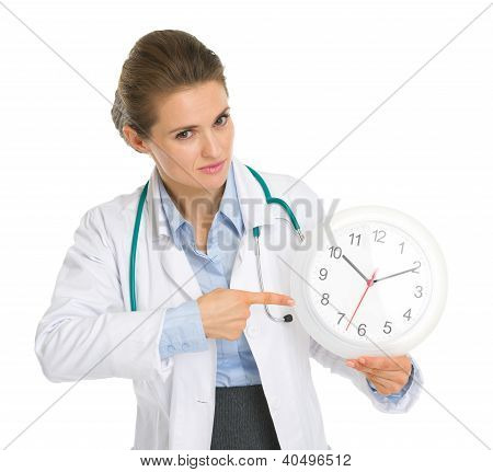 Medical Doctor Woman Pointing On Clock